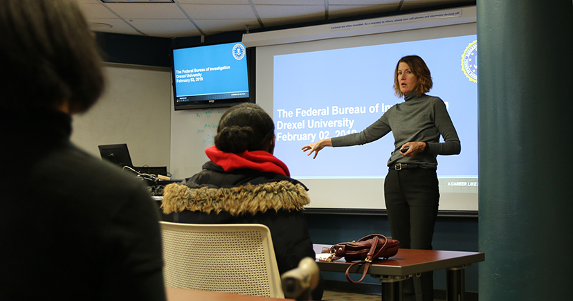 Special Agent Cerena J. Coughlin presents on career opportunities in the FBI during a cyber security workshop for high school students