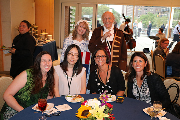 A picture of conference attendees with Ben Franklin and Betsy impersonators