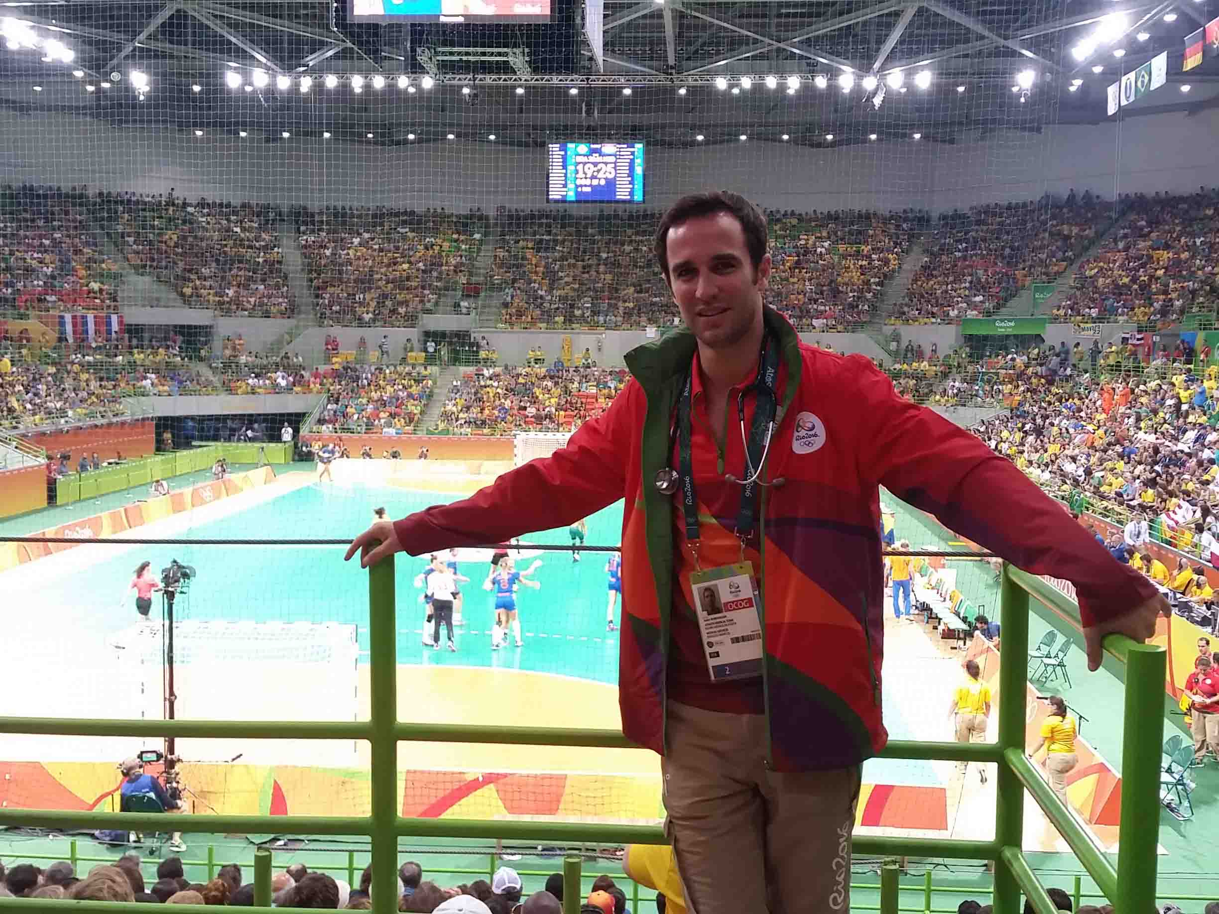 Justin posing in front of handball court at Rio Olympics