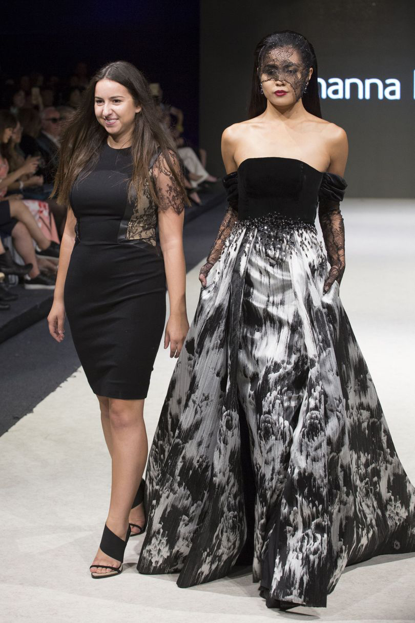Dinardo on runway with model in black dress