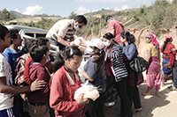 Relief workers handing out food in Nepal in the days following devastating earthquakes in April.