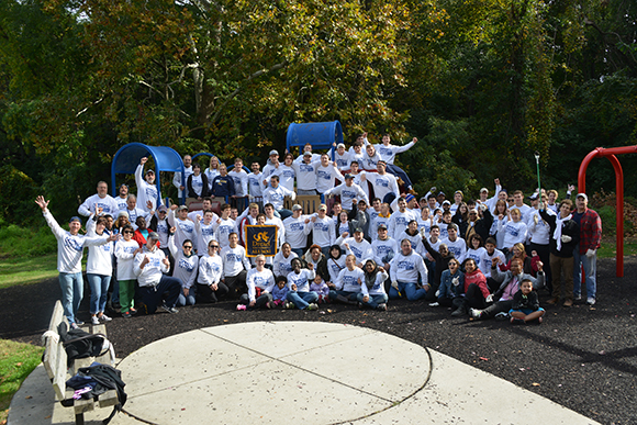 Group photo of volunteers on playground