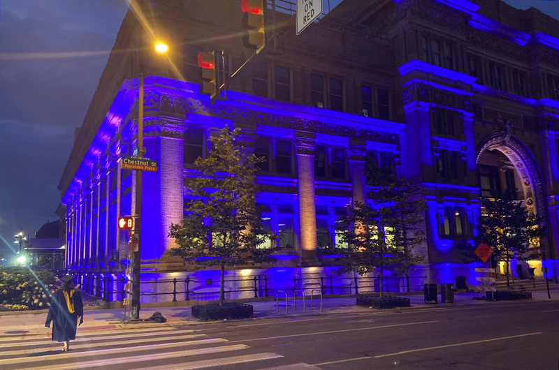 Drexel Main Building Lit up blue and gold