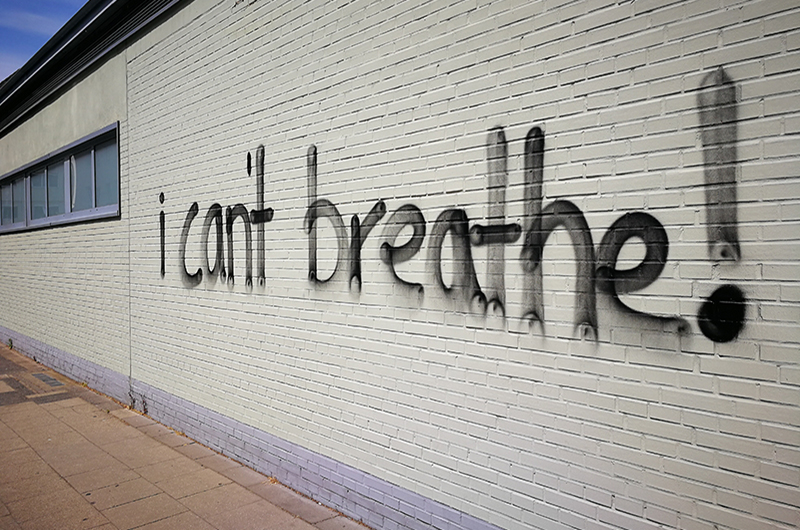 "wall with ""I can't Breathe"" spray painted on"