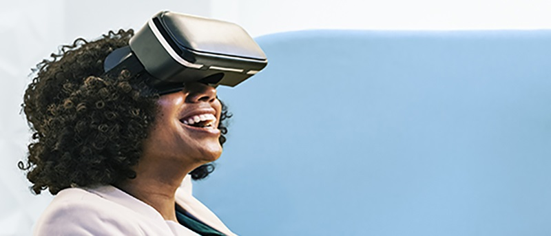 stock image of woman using VR headset