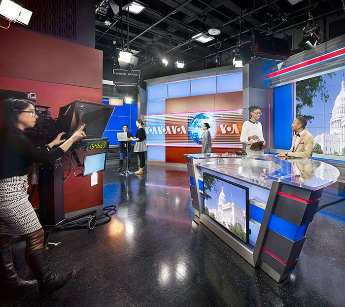 student co-op working on set at Voices of America television show