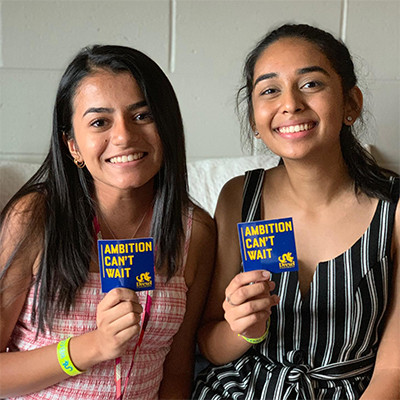 two girls holding stickers
