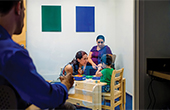 Clinical observation room clinicians with toddler