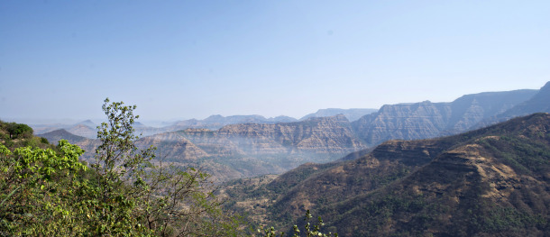 The entire mountainous region shown here is part of the Deccan Traps, showing the characteristic stair-like ridges of lava flows. This photo is from near the town of Mahabaleshwar. Credit: Loÿc Vanderkluysen