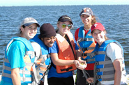 Students with a fish at the Drexel Environmental Science Academy
