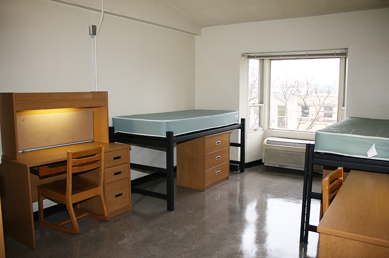 Myers Hall room with two beds, desks, and dressers
