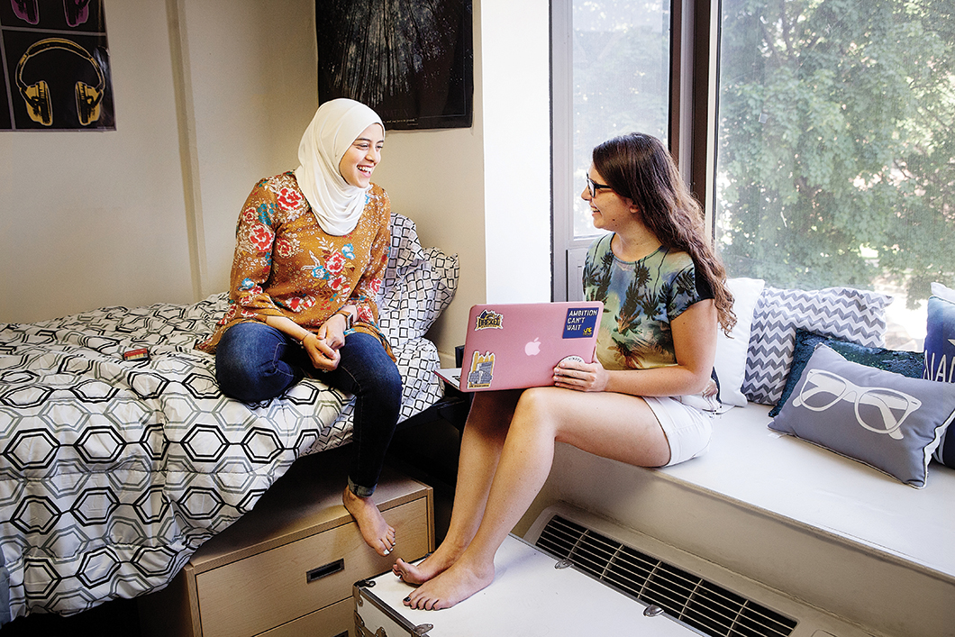 Two female students talking in a Drexel dorm room
