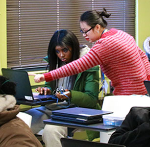 Dean's Ambassador Linh Do assisting a high school student during the Arduino workshop