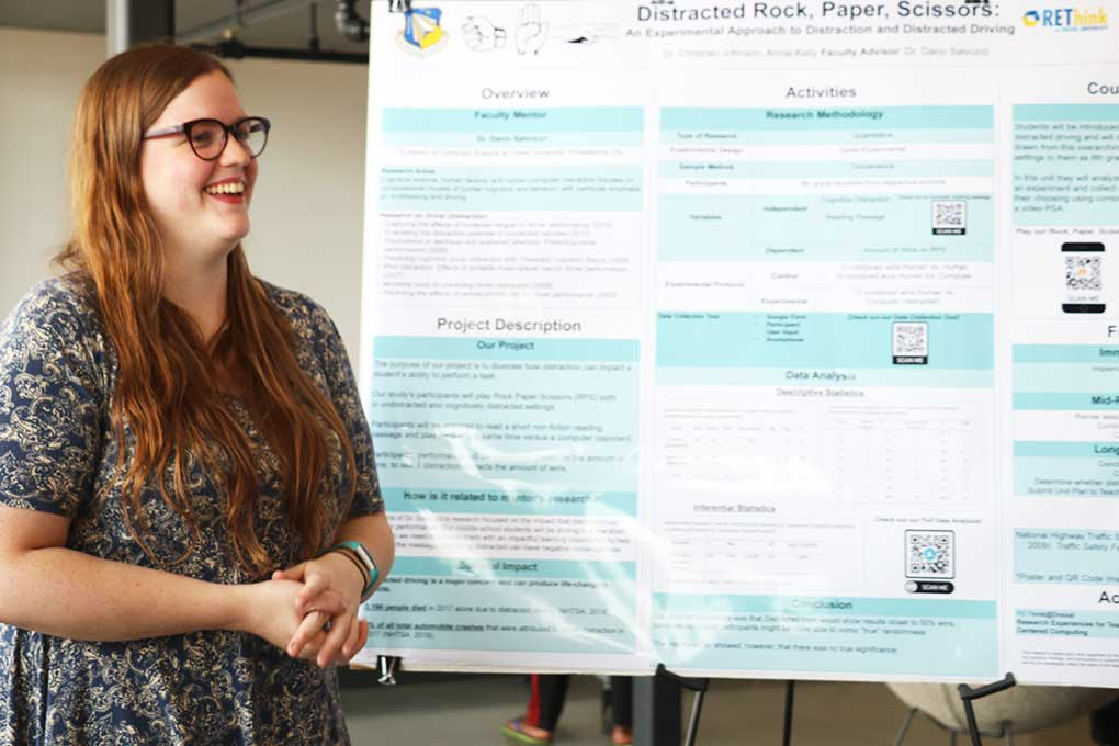 Annie Kelly presenting her work on distracted driving at the REThink Poster Showcase on August 1, 2019.