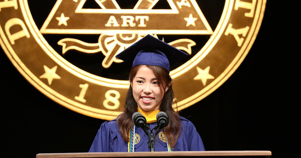 Tiffany Wong (BS Computer Science, '18) speaking at the 2018 Commencement in the Daskalakis Athletic Center.