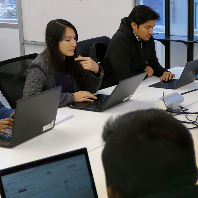 Students studying artificial intelligence at CCI
