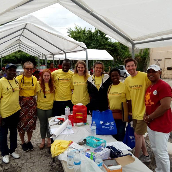 Mandela Fellows join a community health screening in West Philly led by CNHP's Omolabake Fadeyibi