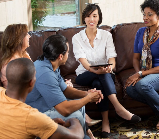 Group of adults in group counseling