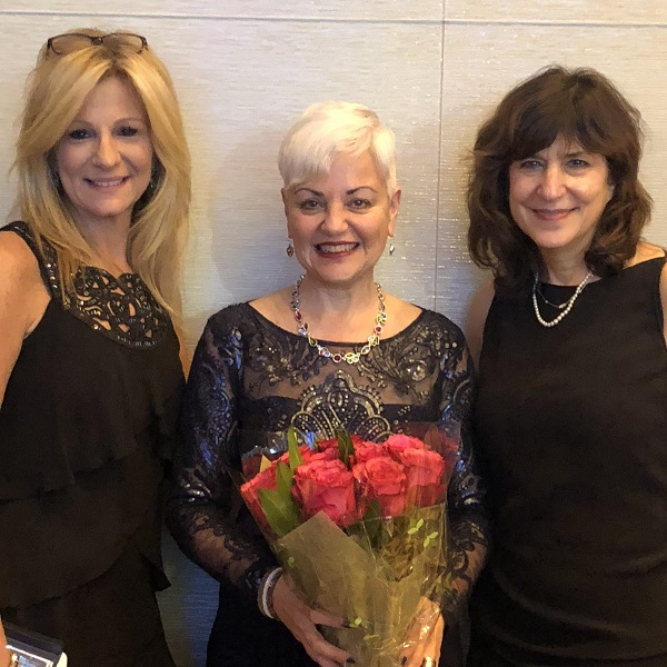 Newly inducted Fellow of the American Academy of Nursing Bobbie Posmontier PhD, CNM, PMHNP-BC, a associate professor in graduate nursing with Kymberlee Montgomery, DNP, APRN, WHNP-BC, CNE, FAANP, FAAN, chair of the Department of Advanced Practice Nursing, and Laura N. Gitlin, dean and distinguished University professor