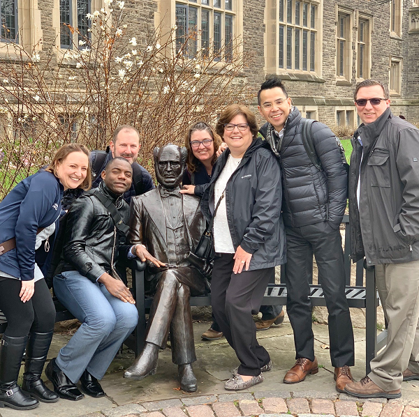 A group of Drexel DNP students poses with a statue of William McMaster. (Photo credit: Christopher Acebedo)