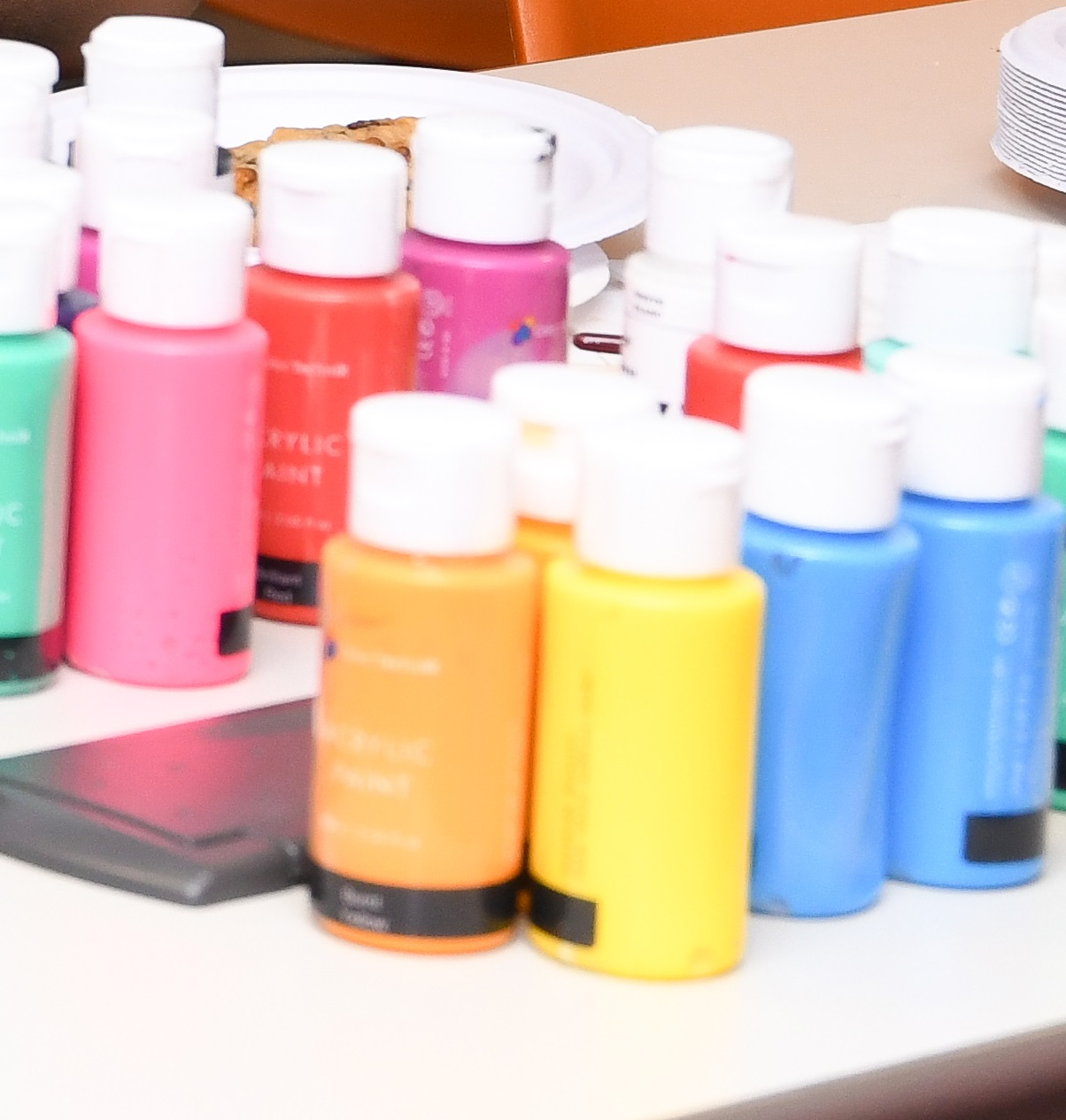 Small bottles of paint in various colors