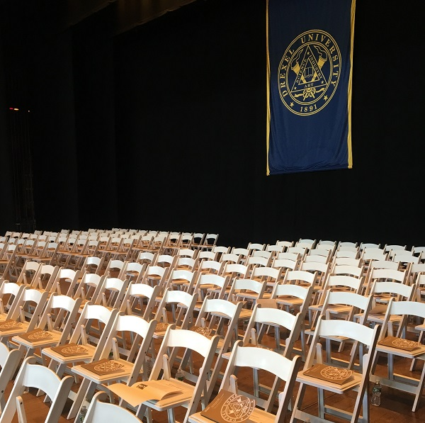 Empty chairs at the Mann Centere before commencement