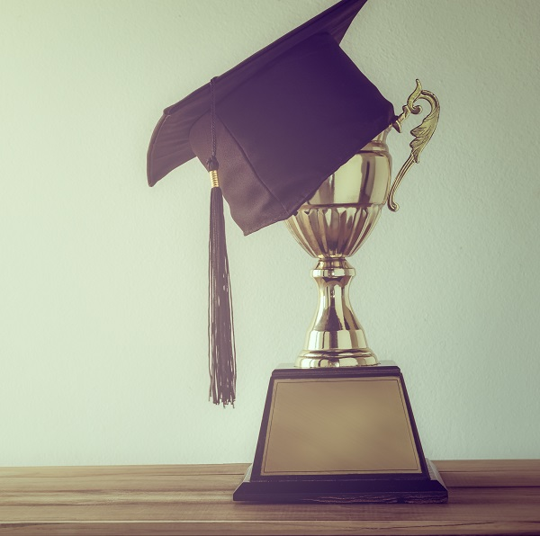 Trophy and graduation cap