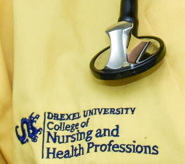 CNHP's logo on yellow scrubs with stethoscope