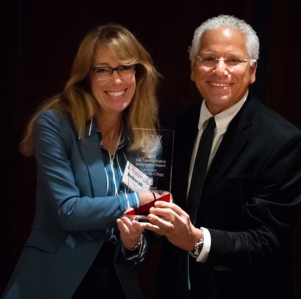 Debbie Clegg, PhD, associate dean of research at CNHP receiving an award from Richard DiMarchi, PhD, the Standiford H. Cox Distinguished Professor of Chemistry at Indiana University