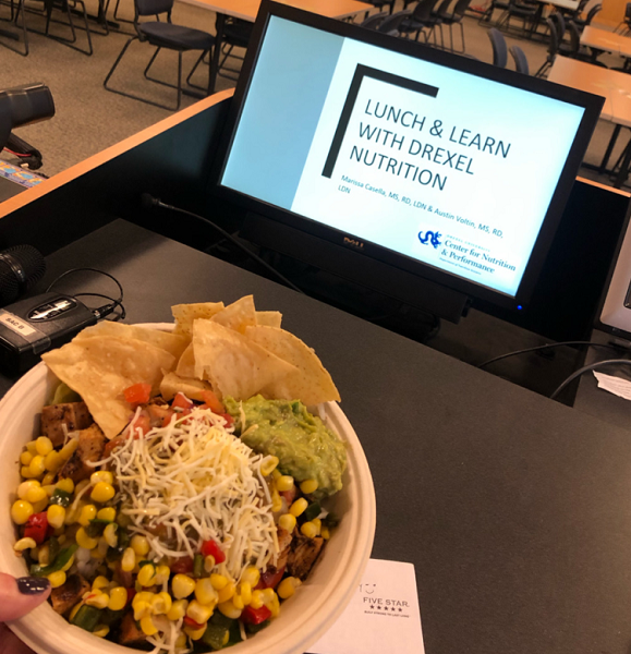 Photo of Mexican meal bowl and computer screen