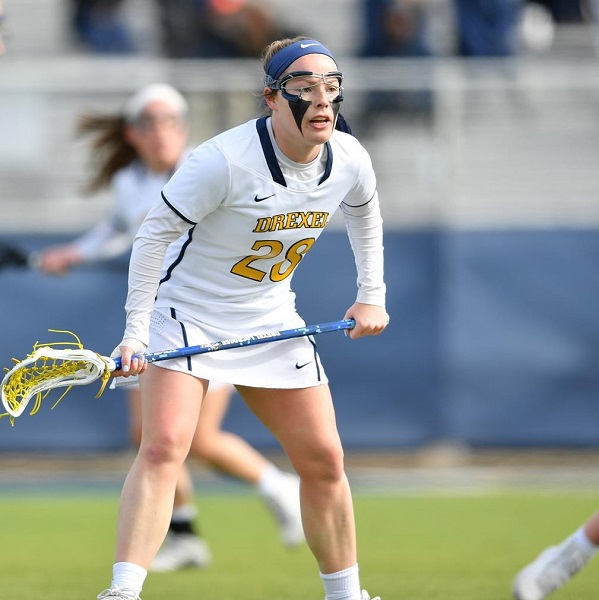 Nursing student Lucy Schneidereith on the lacrosse field
