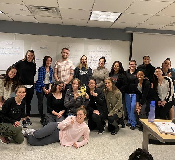 Students in the Nursing Population Health Concepts course posing as a group with FlatFlo