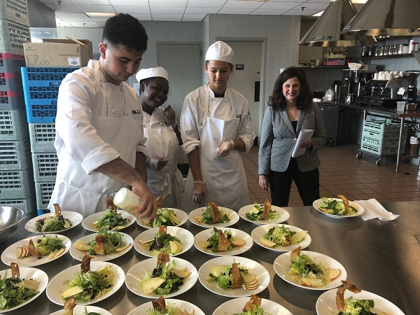 Students plating food in foos and hospitality management class
