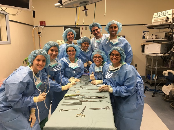 Hope Cline with fellow physician assistant students in scrubs