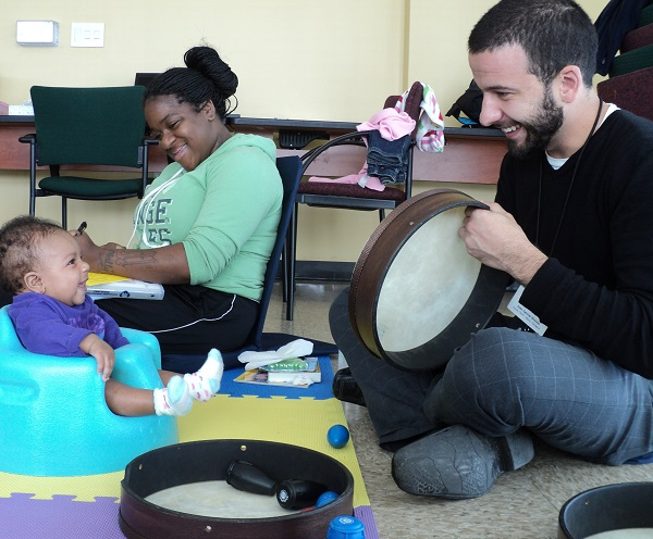 Music therapy with infant at the Stephen and Sandra Sheller 11th Street Family Health Services