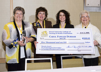 big check and 4 nursing professionals