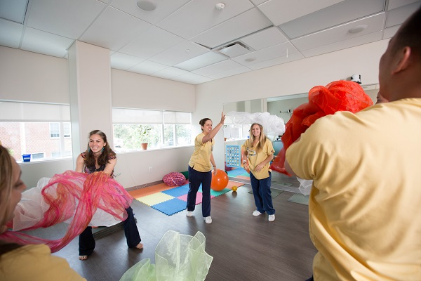 CNHP nursing students using scarves in a dance/movement therapy class