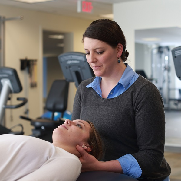 Sara Tomszewski, PT, DPT working with a patient