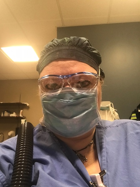 Elizabeth Tomaszewski, DNP, track director of the Adult-Gerontology Acute Care Nurse Practitioner Program (AGACNP) and assistant clinical professor, wearing PPE during her shift