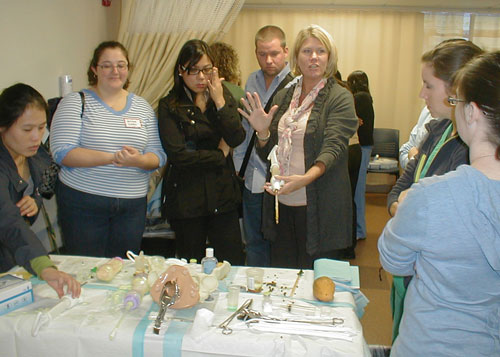 simulation faculty demonstrating to group