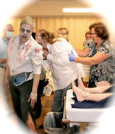 actors dressed as zombies for simulation experience