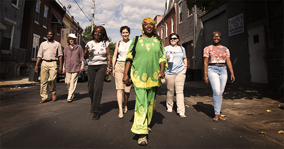 Community Members and Drexel Students walking in a Philadelphia Street