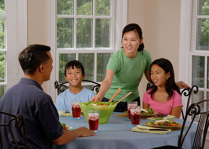 Family having meal at dinner table