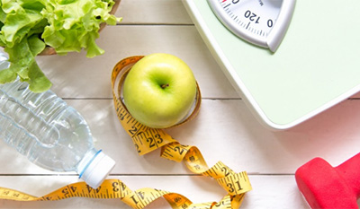 healthy diet - water, apple, scale, lettuce, measuring tape