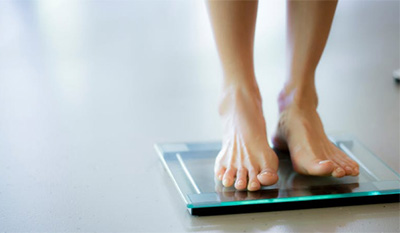 woman's feet on a digital scale