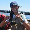 Student holding up a crab at Drexel's Environmental Science Leadeship Academy Summer 2016