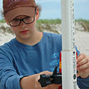 Student taking measurements at Drexel's Environmental Science Leadeship Academy Summer 2016