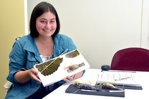Student with bird specimens at the Academy of Natural Sciences of Drexel University