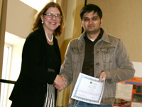 Donna Murasko presents Avi Dalal with 2011 CoAS Research Day Award