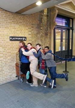Students at Platform 9 3/4 on the London Research Trip